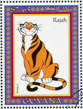 rajah: GUYANA - CIRCA 1993: sello impreso por Guyana, muestra de Aladdin, la pel�cula de animaci�n de Disney, raj�, alrededor del a�o 1993 Editorial