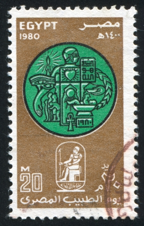 EGYPT - CIRCA 1980: stamp printed by Egypt, shows Emblems, signs, pharaoh, circa 1980 photo
