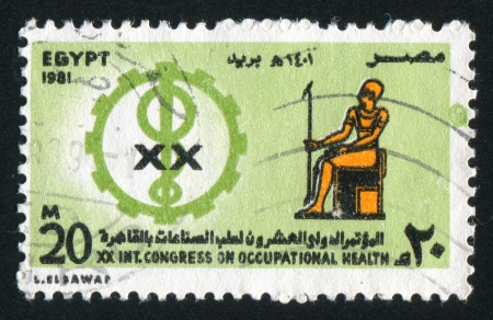 EGYPT - CIRCA 1981: stamp printed by Egypt, shows Occupational Health Congress Emblem, Pharaoh, circa 1981 photo