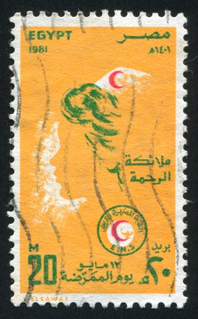 EGYPT - CIRCA 1981: stamp printed by Egypt, shows Nurses Day Emblem, circa 1981 Stock Photo - 13981710