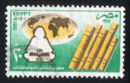 EGYPT - CIRCA 1981: stamp printed by Egypt, shows Books, globe, emblem, circa 1981 photo