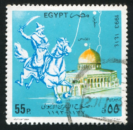 EGYPT - CIRCA 1993: stamp printed by Egypt, shows Medieval warrior, Dome of the Rock, circa 1993 photo