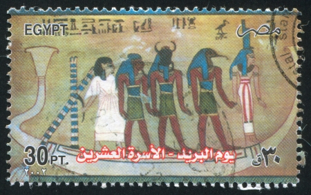 EGYPT - CIRCA 2002: stamp printed by Egypt, shows Painting From Tomb of Anhur Khawi, circa 2002 photo