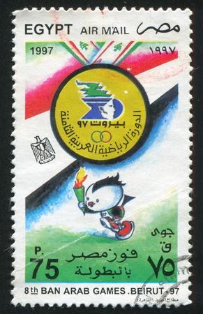 EGYPT - CIRCA 1997: stamp printed by Egypt, shows Emblem, mascot, flag, circa 1997