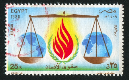 EGYPT - CIRCA 1988: stamp printed by Egypt, shows Emblem, scales, globe, circa 1988 photo