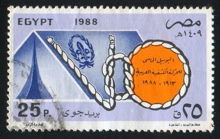 EGYPT - CIRCA 1988: stamp printed by Egypt, shows Emblem, rope, knot, circa 1988 photo