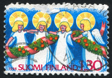 FINLAND - CIRCA 1986: stamp printed by Finland, shows Angels, circa 1986 photo