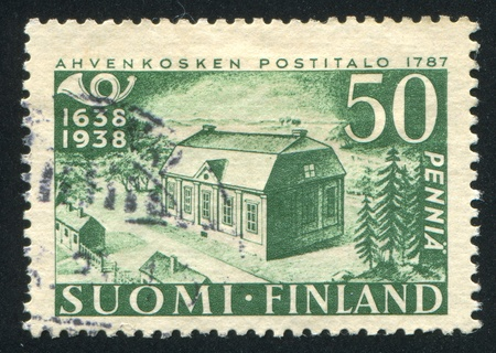 FINLAND - CIRCA 1938: stamp printed by Finland, shows Building of Early Post Office, circa 1938 photo
