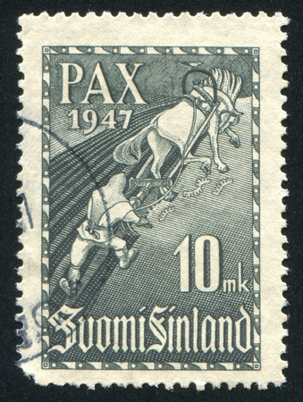 FINLAND - CIRCA 1947: stamp printed by Finland, shows Hero Ilmarinen Plowing  Snake Field, circa 1947 photo