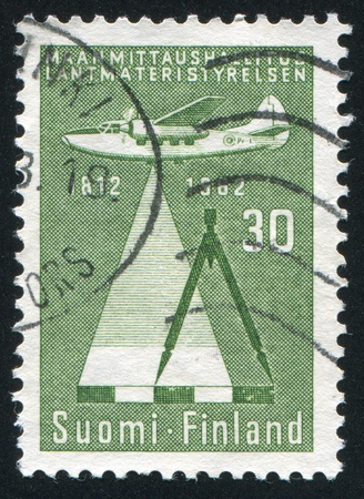 FINLAND - CIRCA 1962: stamp printed by Finland, shows Survey Plane and Compass, circa 1962 Stock Photo - 13981286