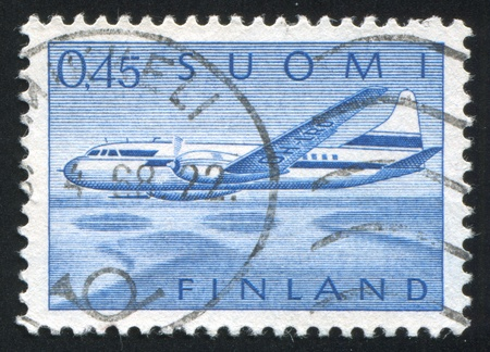 FINLAND - CIRCA 1959: stamp printed by Finland, shows Aircraft Convair 440 over Lake Landscape, circa 1959 photo