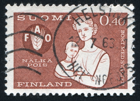 FINLAND - CIRCA 1963: stamp printed by Finland, shows Mother and Child, circa 1963 photo