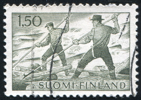 floaters: FINLAND - CIRCA 1963: stamp printed by Finland, shows Log Floaters, circa 1963 Stock Photo