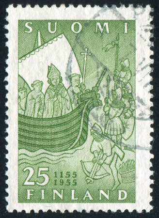 clergy: FINLAND - CIRCA 1955: stamp printed by Finland, shows Bishop Henrik and Clergy on the Ship, circa 1955 Stock Photo