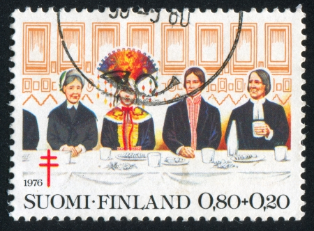 consuetude: FINLAND - CIRCA 1976: stamp printed by Finland, shows Bride, groom, matron and pastor at wedding dinner, circa 1976