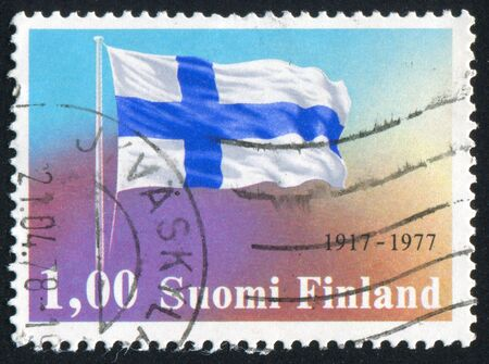 FINLAND - CIRCA 1977: stamp printed by Finland, shows Finnish Flag, circa 1977 photo