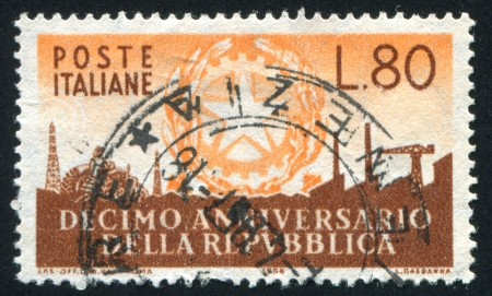 ITALY - CIRCA 1956: stamp printed by Italy, shows Arms of Republic and Symbols of Industry, circa 1956 photo