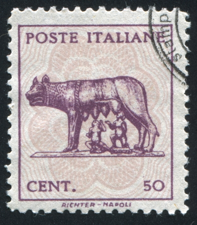 ITALY - CIRCA 1944: stamp printed by Italy, shows Wolf Suckling Romulus and Remus, circa 1944 Stock Photo - 13981567