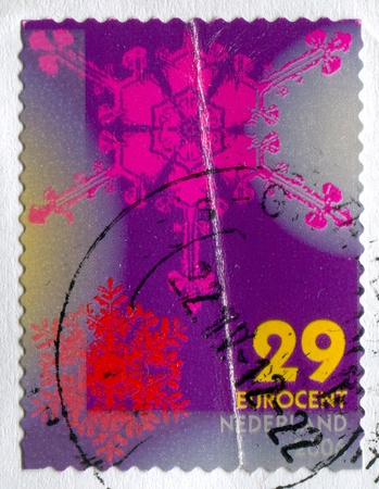 conglomeration: NETHERLANDS - CIRCA 2006: stamp printed by Netherlands, shows Snowflakes, Large pink, small red flakes, circa 2006