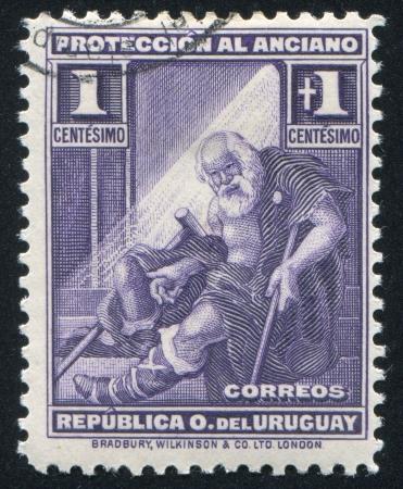 indigent: URUGUAY - CIRCA 1930: stamp printed by Uruguay, shows Indigent Old Man, circa 1930