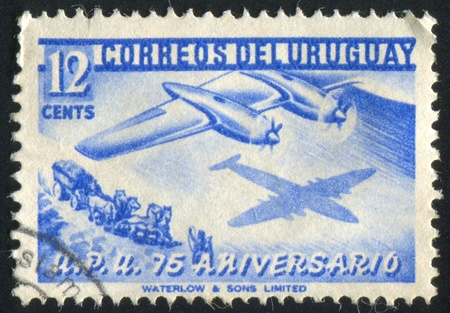 URUGUAY - CIRCA 1952: stamp printed by Uruguay, shows Plane and Stagecoach, circa 1952 photo