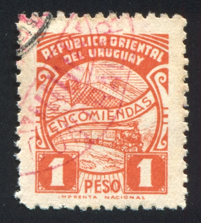 URUGUAY - CIRCA 1938: stamp printed by Uruguay, shows Ship and Train, circa 1938 photo