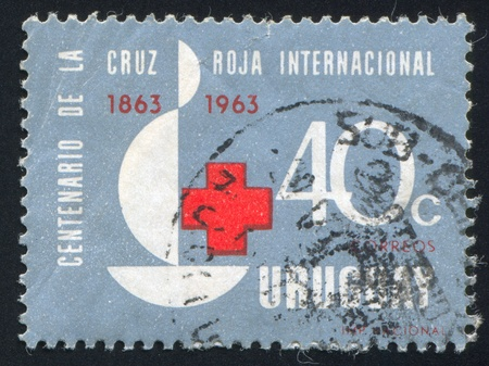 URUGUAY - CIRCA 1964: stamp printed by Uruguay, shows Red Cross, Centenary Emblem, circa 1964 Stock Photo - 14136953