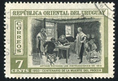 dictating: URUGUAY - CIRCA 1952: sello impreso por el Uruguay, Artigas muestra Instrucciones para dictar, alrededor de 1952
