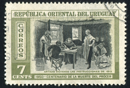 URUGUAY - CIRCA 1952: stamp printed by Uruguay, shows Artigas Dictating Instructions, circa 1952 Stock Photo - 14137228