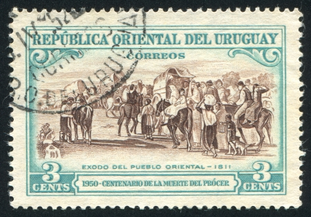 URUGUAY - CIRCA 1952: stamp printed by Uruguay, shows Flight of the People, circa 1952 photo