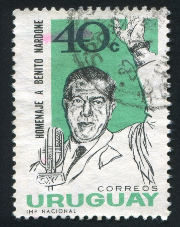 URUGUAY - CIRCA 1965: stamp printed by Uruguay, shows Benito Nardone Before Microphone, circa 1965 Stock Photo - 14136963