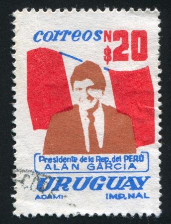 URUGUAY - CIRCA 1986: stamp printed by Uruguay, shows Garcia, Peruvian Flag, circa 1986 Stock Photo - 14137043