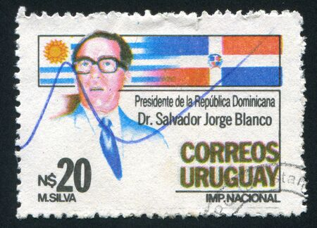 URUGUAY - CIRCA 1986: stamp printed by Uruguay, shows President Blanco, National and Dominican Flags, circa 1986 Stock Photo - 14137053