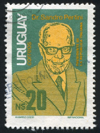 URUGUAY - CIRCA 1986: stamp printed by Uruguay, shows State Visit of President Sandro Pertini of Italy, circa 1986 Stock Photo - 14137018