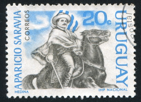 URUGUAY - CIRCA 1966: stamp printed by Uruguay, shows Aparicio Saravia, revolutionary, on horseback, circa 1966 Stock Photo - 14136975