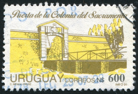 URUGUAY - CIRCA 1991: stamp printed by Uruguay, shows Entrance to Sacramento Colony, circa 1991 photo