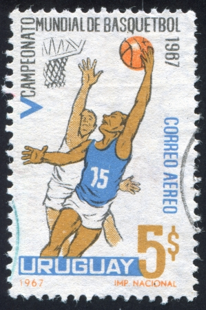 URUGUAY - CIRCA 1967: stamp printed by Uruguay, shows Shooting for Basket, circa 1967 photo