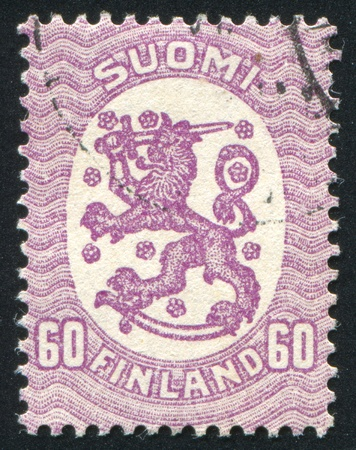 FINLAND - CIRCA 1929: stamp printed by Finland, shows Coat of arms of Finland, circa 1929 photo