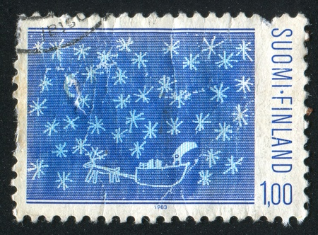 FINLAND - CIRCA 1983:  stamp printed by Finland, shows snowflakes, Santa Claus in reindeer sledge, circa 1983 photo