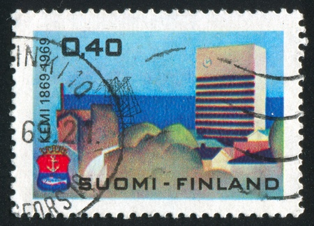 FINLAND - CIRCA 1969:  stamp printed by Finland, shows town, port, circa 1969 photo