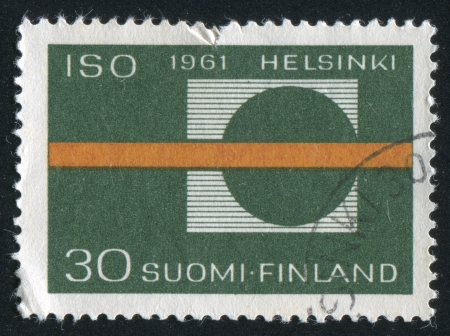standardization: FINLAND - CIRCA 1961:  stamp printed by Finland, shows symbol of standardization, circa 1961.
