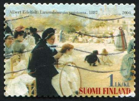 FINLAND - CIRCA 2004:  stamp printed by Finland, shows women in Luxembourg Garden, picture of Albert Edelfelt, circa 2004 photo