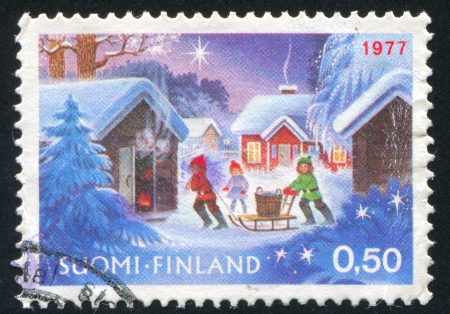 finland sauna: FINLAND - CIRCA 1977:  stamp printed by Finland, shows children bringing water, circa 1977