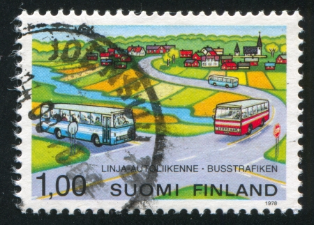 FINLAND - CIRCA 1978:  stamp printed by Finland, shows bus in road, circa 1978 photo