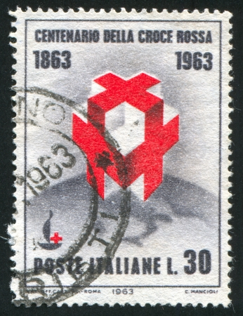 ITALY - CIRCA 1963: stamp printed by Italy, shows Crosses and Centenary Emblem on Globe, circa 1963