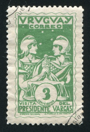 law of brazil: URUGUAY - CIRCA 1935: stamp printed by Uruguay, shows Uruguay and Brazil Holding Scales of Justice, circa 1935