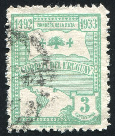 URUGUAY - CIRCA 1933: stamp printed by Uruguay, shows Flag of the Race and Globe, circa 1933 photo