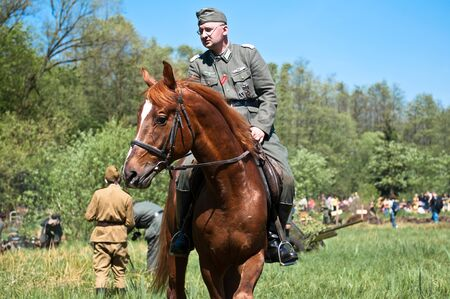 cavalryman: KALININGRAD, RUSSIA  - May 09: Reconstruction of the Great War (Russian-Germany) battle, reconstruction of combat between Soviet and German armies, May 09, 2012 in Kaliningrad, Russia. Editorial