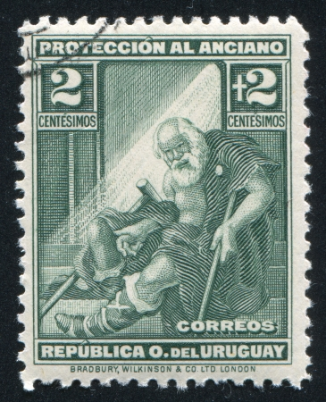 URUGUAY - CIRCA 1930: stamp printed by Uruguay, shows Indigent Old Man, circa 1930