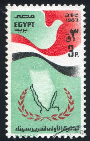 EGYPT - CIRCA 1983: stamp printed by Egypt, shows Emblem, Stylized egypt flag, circa 1983 photo